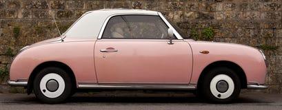 Rosafarbenes Auto Stockbilder