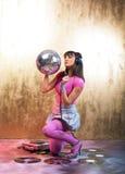 Rosafarbenes Disco-Mädchen Stockfoto