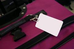 Rosafarbenes Gepäck Stockfotos
