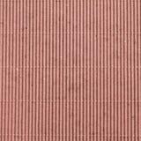 Rosafarbenes gewölbtes Kartonmuster Stockbild