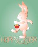 Rosafarbenes Kaninchen mit Ostereiern Lizenzfreies Stockfoto