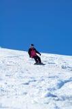 Rosafarbenes Snowboardmädchen Stockfotografie