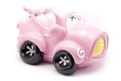 Rosafarbenes Spielzeugauto Stockfotografie