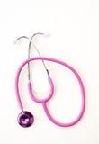 Rosafarbenes Stethoskop auf Weiß Stockbilder