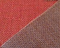 Rosafarbenes u. purpurrotes Gewebe in der Diagonale Lizenzfreies Stockbild