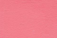 Rosarosenzementputzwand-Beschaffenheitshintergrund Stockbild