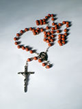 Rosary. Close up view of a Rosary on a shadows background royalty free stock photos