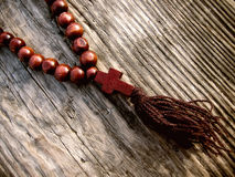 Rosary. Wooden beads on the table Royalty Free Stock Image