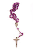 Rosary. Praying beads called rosary made of purple glass and photographed on white background Royalty Free Stock Photo
