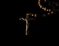 Rosary. A rosary on a black background stock photo