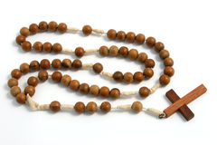 Rosary. A wood rosary on a white background Royalty Free Stock Image