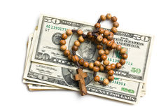Rosary with american dollars Stock Photos