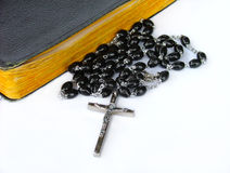Rosary beads. With bible stock photography