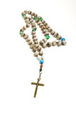 Rosary beads. Of decorated hazlenuts from low perspective isolated against white stock photo