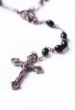 Rosary Beads. Closeup image of a cross at the end of a string of rosary beads stock images