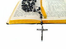 Rosary beads on bible. Rosary beads on open bible royalty free stock image