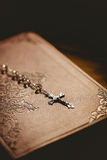 Rosary beads with bible Royalty Free Stock Photo