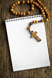 Rosary beads and blank notebook Royalty Free Stock Photos