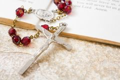 Rosary beads on a book of psalms. And sandstone background stock photo