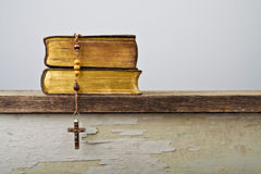 Rosary beads and books of Catholic Church liturgy royalty free stock image