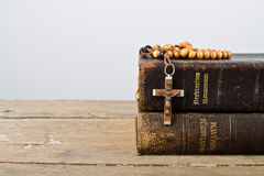 Rosary beads and books of Catholic Church liturgy Stock Image