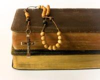 Rosary beads and breviary Stock Photo