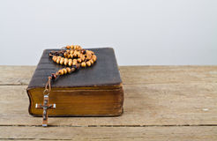 Rosary beads and breviary Stock Photo