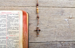 Rosary beads and breviary. The book of Catholic Church liturgy and rosary beads on the wooden table Royalty Free Stock Photography