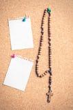 Rosary beads on cork board Stock Photo