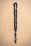Rosary beads on cork board Stock Photo
