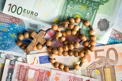 Rosary beads on euro bills. Top view of rosary beads on euro bills royalty free stock photography