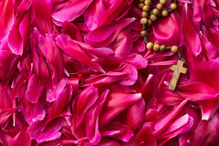 Rosary beads on flower background. Stock Photos