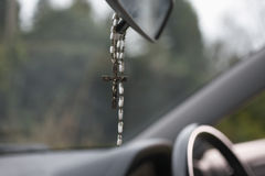 Rosary Beads Hanging In Car Stock Images