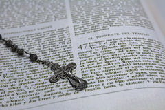 Rosary beads and a holy bible Stock Photos