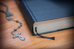 Rosary beads and a holy bible Royalty Free Stock Photos