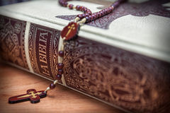 Rosary beads and a holy bible Stock Images