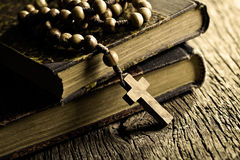 Rosary beads on old books. Vintage rosary beads on old books royalty free stock photography
