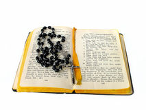 Rosary beads open bible. Rosary beads on open bible stock image