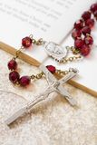 Rosary beads and psalms. Rosary beads on a book of psalms royalty free stock photos
