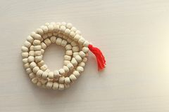 Rosary or beads from the sacred tree of Tulasi with a red tassel stock image