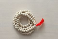 Rosary or beads from the sacred tree of Tulasi with a red tassel royalty free stock photography