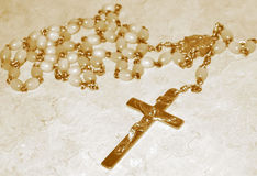 Rosary Beads, sepia. Rosary beads in sepia. They are about 45 years old royalty free stock photos