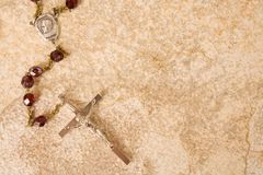 Rosary beads on stone. Rosary beads on a sandstone background royalty free stock photography