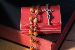 Rosary Beads and Two Holy Bibles Stock Photo