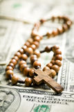 Rosary beads on us dollars Royalty Free Stock Image