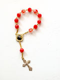 Rosary Beads on white background. Red Rosary Beads on white background isolated stock images