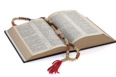 Rosary and bible. Nephritic rosary over an holy bible Royalty Free Stock Images