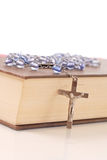 Rosary On Bible Stock Photos