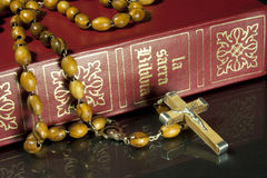 Rosary and bible. Wooden rosary on bible black background Stock Photo