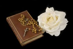 Rosary and bible Stock Image